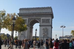 The Arc de Triomphe de l'Étoile. It stands in the centre of the Place Charles de Gaulle, at the western end of the Champs-Élysées.